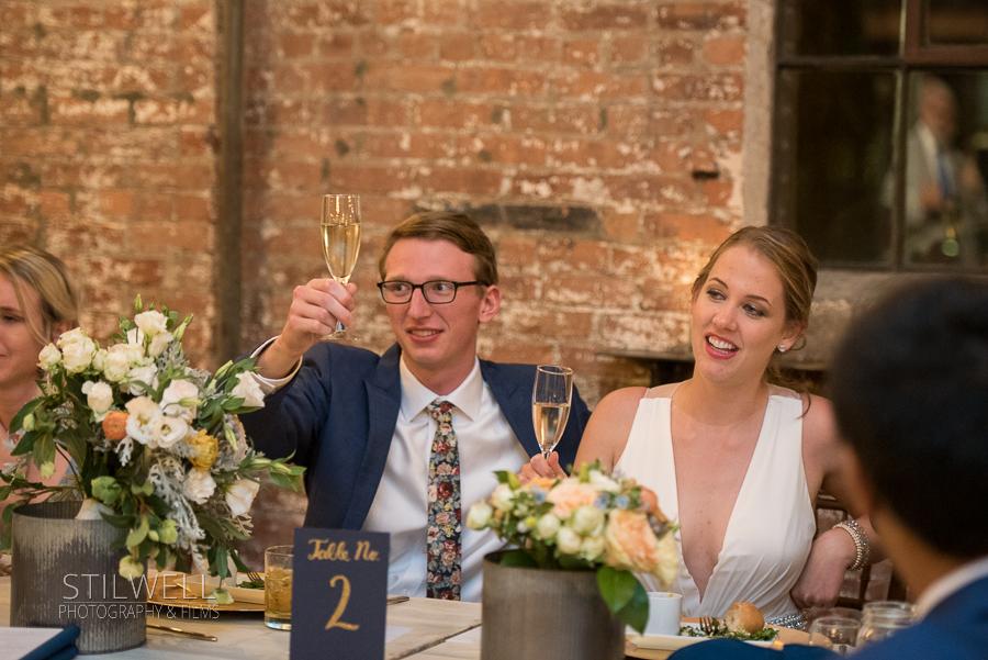 Couple Toasts Senate Garage Reception